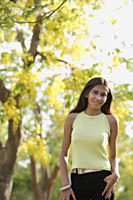 teen girl standing under blooming tree - Alex Mares-Manton