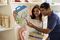 couple looking at baby items - Alex Mares-Manton