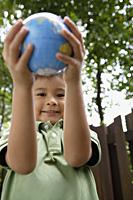 Boy holding up globe - Yukmin