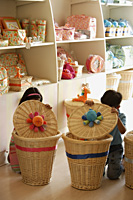kids in shop looking in baskets - Alex Mares-Manton