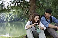 couple resting under tree - Yukmin