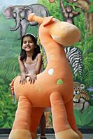little girl with big stuffed giraffe - Alex Mares-Manton