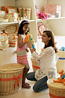 mother and daughter in toy store - Alex Mares-Manton