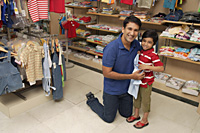 father and son shopping for clothes - Alex Mares-Manton