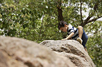 boy climbing on rocks - Alex Mares-Manton