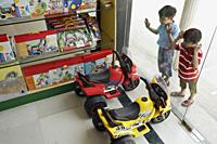 Little boys staring in toy store window - Alex Mares-Manton