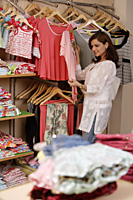 woman shopping for children's clothing - Alex Mares-Manton