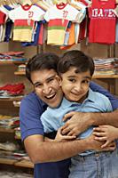 father and son in shop - Alex Mares-Manton