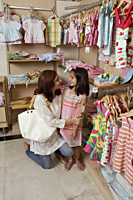 mother and daughter shopping for clothes - Alex Mares-Manton