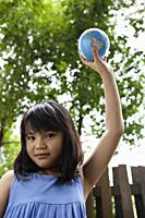 Girl holding up globe - Yukmin