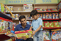 father and son shopping for toys - Alex Mares-Manton