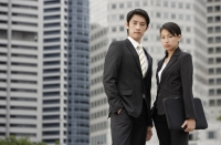 Portrait of colleagues in front of buildings - Yukmin