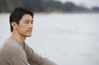Profile of man sitting next to bay - Yukmin