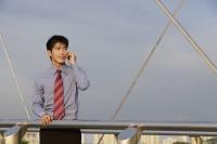 Businessman speaking on mobile phone - Yukmin