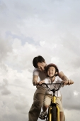 Father teaching son how to ride bike - Yukmin