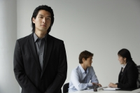Business colleagues, businessman in foreground - Yukmin