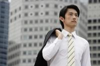 Portrait of businessman with jacket over shoulder - Yukmin