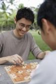 Two men playing Chinese chess in park - Yukmin