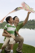 Father and son playing with kite - Yukmin