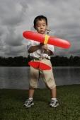 Young boy holding toy airplane - Yukmin