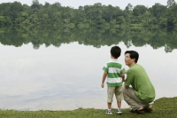 Father and son talking by lake - Yukmin