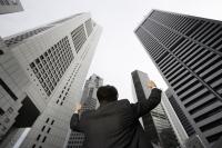 Businessman raising arms in air - Yukmin