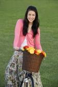 Portrait of young woman on bike - Yukmin