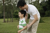 Father and son playing in park - Yukmin