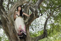 Young woman in tree - Yukmin