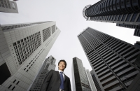 Businessman among buildings - Yukmin