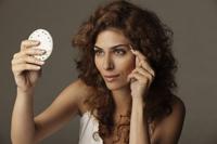 Young woman plucking eyebrows - Vivek Sharma