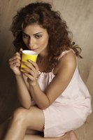 Woman drinking hot tea - Vivek Sharma