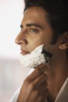 Man shaving his face - Alex Mares-Manton