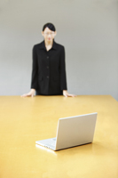 businesswoman staring at laptop on conference table - Yukmin