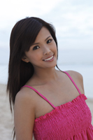 Woman smiling on beach - Yukmin