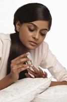 woman applying nail polish - Vivek Sharma