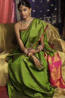 woman wearing sari, surrounded by sari fabric, decorated with henna tattoos, jewelry and bindi - Vivek Sharma