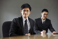 Businessmen in conference room - Yukmin