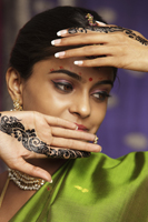 woman with hands decorated in henna - Vivek Sharma