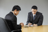 two businessmen having a meeting - Yukmin