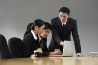 Three colleagues working in conference room - Yukmin