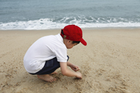 boy playing on beach - Yukmin