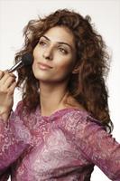 woman applying blush - Vivek Sharma