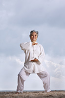 Older woman doing martial arts. - Yukmin