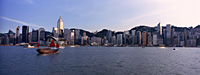 Hong Kong skyline with a chinese junk in the Victoria Harbour - OTHK