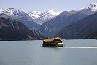 An excusrion boat on Tianshan Lake (Lake of Heaven), Wulumuqi, Xinjiang, China - OTHK