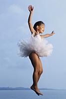 Girl jumping in air wearing tutu. - Yukmin