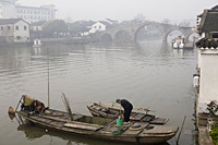 A man cleaning his boat in the morning,  Zhujiajiao, China - OTHK