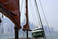 Chinese junk 'Duckling'  at Victoria Harbour with the background of skyscrapers in Central & Star Ferry, Hong Kong - OTHK