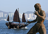Chinese junk and Bruce Lee statue at Victoria Harbour, Hong Kong - OTHK